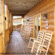 Large porch with rocking chairs in cabin 854 (The Wagon Wheel Lodge) at Eagles Ridge Resort at Pigeon Forge, Tennessee.