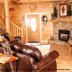 Cozy living room in cabin 854 (The Wagon Wheel Lodge) at Eagles Ridge Resort at Pigeon Forge, Tennessee.