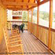 Back porch with rocking chairs in cabin 856 (Eagles Pointe) , in Pigeon Forge, Tennessee.