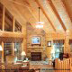 Den with vaulted ceilings and fireplace in cabin 856 (Eagles Pointe) , in Pigeon Forge, Tennessee.