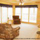 Great room with fireplace in cabin 856 (Eagles Pointe) , in Pigeon Forge, Tennessee.