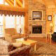 Living room with fireplace in cabin 856 (Eagles Pointe) , in Pigeon Forge, Tennessee.