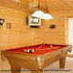 Game room with pool table in cabin 856 (Eagles Pointe) , in Pigeon Forge, Tennessee.