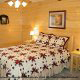 Bedroom with Night Stands in Cabin 858 (Eagles On A High) at Eagles Ridge Resort at Pigeon Forge, Tennessee.