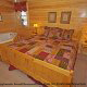 Country bedroom in cabin 859 (Absolute Paradise) , in Pigeon Forge, Tennessee.