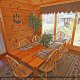 Dining room with a view in cabin 859 (Absolute Paradise) , in Pigeon Forge, Tennessee.