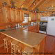 Fully furnished country kitchen in cabin 859 (Absolute Paradise) , in Pigeon Forge, Tennessee.