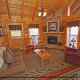 Living room with fireplace in cabin 859 (Absolute Paradise) , in Pigeon Forge, Tennessee.
