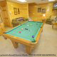 Game room with pool table in cabin 859 (Absolute Paradise) , in Pigeon Forge, Tennessee.