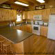Kitchen View of Cabin 860 (Cozy Bear Overlook) at Eagles Ridge Resort at Pigeon Forge, Tennessee.