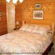 Country pine bedroom in cabin 861 (Mountain View Lodge) at Eagles Ridge Resort at Pigeon Forge, Tennessee.