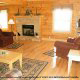 Living room with fireplace in cabin 861 (Mountain View Lodge) at Eagles Ridge Resort at Pigeon Forge, Tennessee.