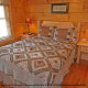 Country bedroom in cabin 864 (The Cedars) at Eagles Ridge Resort at Pigeon Forge, Tennessee.