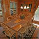Large country dining room in cabin 864 (The Cedars) at Eagles Ridge Resort at Pigeon Forge, Tennessee.