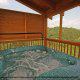 Outdoor deck with hot tub in cabin 864 (The Cedars) at Eagles Ridge Resort at Pigeon Forge, Tennessee.