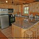 Fully furnished country kitchen in cabin 864 (The Cedars) at Eagles Ridge Resort at Pigeon Forge, Tennessee.