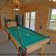 Game room with pool table in cabin 864 (The Cedars) at Eagles Ridge Resort at Pigeon Forge, Tennessee.