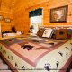 One of the many fully furnished luscious bedrooms in cabin 88 (Mountain Magic), in Pigeon Forge, Tennessee.