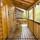 Rock yourself to sleep on this patio in cabin 88 (Mountain Magic), in Pigeon Forge, Tennessee.