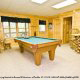 Play a game of pool on this pool table in cabin 88\'s game room (Mountain Magic), in Pigeon Forge, Tennessee.