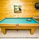Play a game of pool on this large pool table in cabin 88 (Mountain Magic), in Pigeon Forge, Tennessee.
