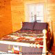 Country bedroom in cabin 91 (Eagles Beauty) , in Pigeon Forge, Tennessee.