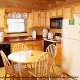 Dining room with kitchen in cabin 91 (Eagles Beauty) , in Pigeon Forge, Tennessee.