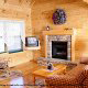 Living room with fireplace in cabin 91 (Eagles Beauty) , in Pigeon Forge, Tennessee.