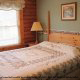 Bedroom View with King Size Bed in Cabin 92 (Virginias Villa) at Eagles Ridge Resort at Pigeon Forge, Tennessee.
