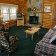 Living Room View with Fire Place in Cabin 92 (Virginias Villa) at Eagles Ridge Resort at Pigeon Forge, Tennessee.