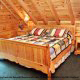 Bedroom View with two Night Stands in Cabin 93 (Pirates Cove) at Eagles Ridge Resort at Pigeon Forge, Tennessee.