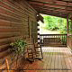 Front Porch View with Rocking Chair in Cabin 93 (Pirates Cove) at Eagles Ridge Resort at Pigeon Forge, Tennessee.