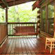 Porch View with Swing in Cabin 93 (Pirates Cove) at Eagles Ridge Resort at Pigeon Forge, Tennessee.