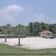 Volleyball court by the pond at The Star Island Resort in Orlando Florida.