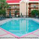 Outdoor Pool with Chaise Lounge Chairs at the Hampton Inn Hotel in Gulfport, near Biloxi, Mississippi. Take the plunge and feel like a child again during your Halloween Vacation Getaway.