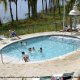 Outdoor Pool View of Blue Heron Resort in Orlando, Florida. Watch your children play during your Spring Break Vacation.