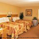 Double Queen size beds with modern styling for this deluxe hotel room at The Champions World Resort in Orlando, Florida. Best Destination for your Valentine's Day Vacation getaway.