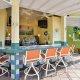 Comfort Suites Maingate East Resort bar overview