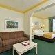 Comfort Suites Maingate East Resort queen room