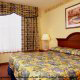 King Size Room View at Country Inn & Suites By Carlson Orlando-Maingate at Calypso in Orlando, Florida. Relax and have fun during your Valentines Day Romantic Getaway.