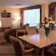 Spacious living room and dining room at the Crowne Plaza Hotel Orlando - Universal in Orlando, Florida.