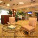 Relax and read a book in the spacious Waiting Area in the Lobby at Crowne Plaza Hotel Orlando - Universal in Orlando, Florida.