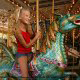 Young girl enjoying a Carousel ride at Dollywood in Pigeon Forge, Tennessee.