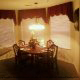Another view of the dining room and its relationship to the kitchen at The Suites At Fall Creek in Branson Missouri.