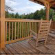 Back Porch With Rocking Chair in Mountain Lake Retreat Cabin at Gatlinburg, Tennessee.