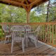 Deck With Table Overlooking Nature in Mountain Lake Retreat Cabin at Gatlinburg, Tennessee.