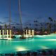 The Gran Meliá opens to Puerto Rico\'s largest lagoon-style pool, featuring four integrated whirlpools, submersed in a scene of lush foliage at Gran Melia Gulf Resort, Rio Grande, Puerto Rico.