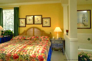 Bedroom Furnished With Tropical Decor For A Perfect Vacation To The Grand Beach Resort Condos In