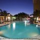 Night Pool View at Hilton Garden Inn in Orlando, Florida. Take a refreshing splash in the cool waters during your Spring Break Family Getaway.
