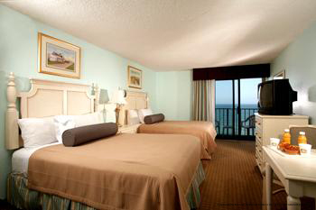 View of a double bedroom with an ocean view from a private balcony at The Best Western Carolinian in Myrtle Beach